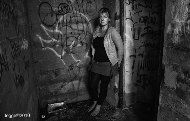 woman in doorway with graffiti